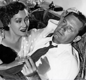 "Gloria Swanson with her 'victim' William Holden in the classic film noir ""Sunset Boulevard"""