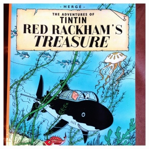 "An older edition of one of the TinTin comics used for the film's plot ""Red Rackham's Treasure"""
