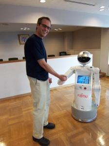 The Enon Robot from Fujitsu and a human friend. (Photo by Ms. President via Flickr)