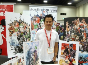 Dustin Nguyen surrounded by a 'Bat Family' of his own art. (Photo by PatLoika via Flickr).
