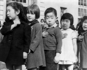 Lange's pictures documenting the Japanese-American Internment are evocative and unabashedly political, such as this photo of Japanese-American Children pledging Allegiance to the Flag prior to their internment.