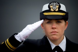 Ship's Navigator Lt. j.g. Shaina Hayden renders honors to the national anthem during the commissioning ceremony for the littoral combat ship USS Freedom (LCS 1) at Veterans Park in Milwaukee, Wis. (Photo by Mass Communication Specialist 2nd Class Kevin S. O'Brien)